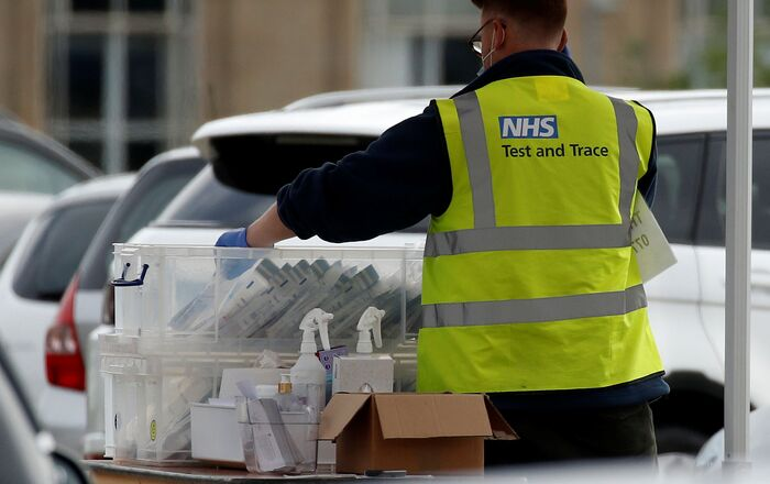 An NHS test and trace worker sorts through coronavirus (COVID-19) tests at a drive-through testing facility in Bolton, Britain, 7 September 2020. REUTERS/Phil Noble