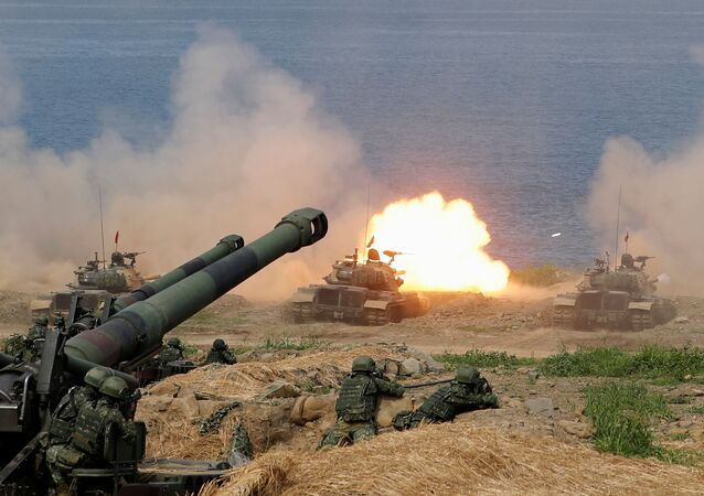 FILE PHOTO: A CM-11 Brave Tiger tank fires during the live fire Han Kuang military exercise, which simulates China's People's Liberation Army (PLA) invading the island, in Pingtung, Taiwan May 30, 2019