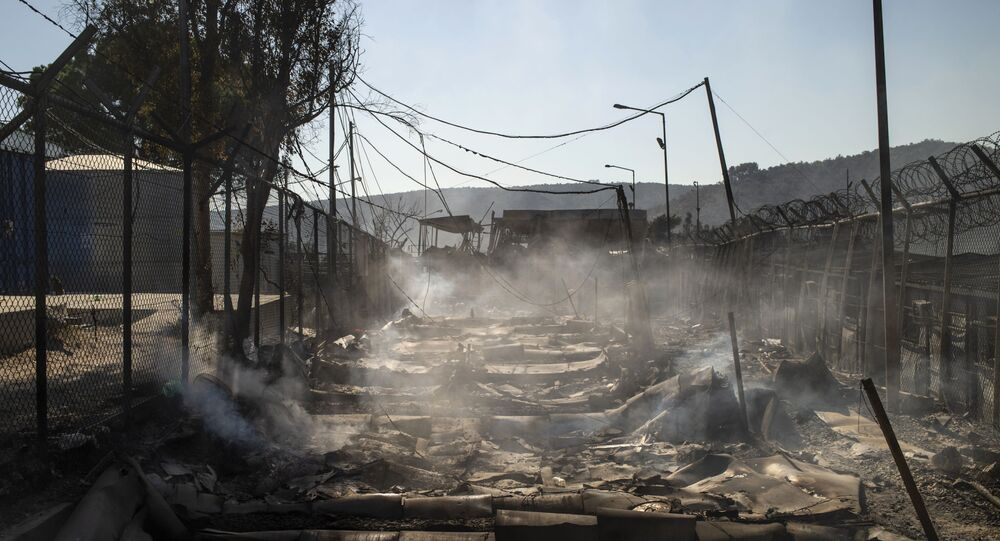 A picture taken on September 9, 2020 shows the burnt camp of Moria on the island of Lesbos after a major fire broke out.