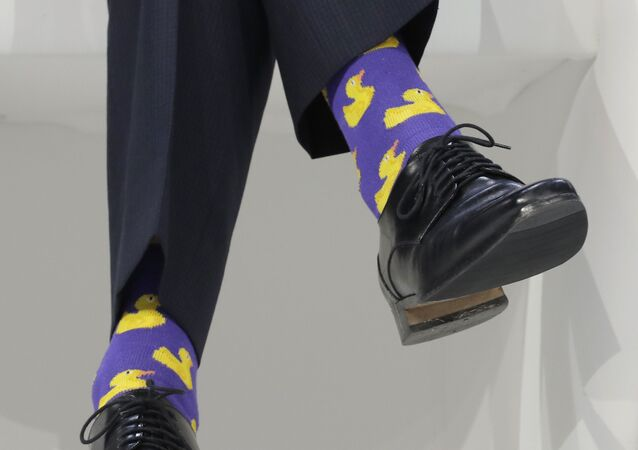 Justin Trudeau, Prime Minister of Canada, sports duck socks during the annual meeting of the World Economic Forum in Davos, Switzerland, Thursday, Jan. 25, 2018.