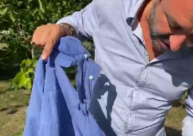 Leader of Italy's far-right League party Matteo Salvini displays his shirt that was ripped by a woman who assaulted him while he was campaigning in the town of Pontassieve in the central region of Tuscany, during a live steam on his Facebook page from Mugello, Italy, in this still image taken from video, September 9, 2020.