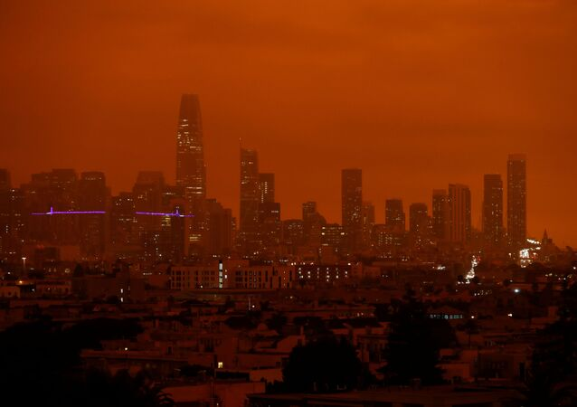 Downtown San Francisco is seen from Dolores Park under an orange sky darkened by smoke from California wildfires in San Francisco, California, U.S. September 9, 2020.