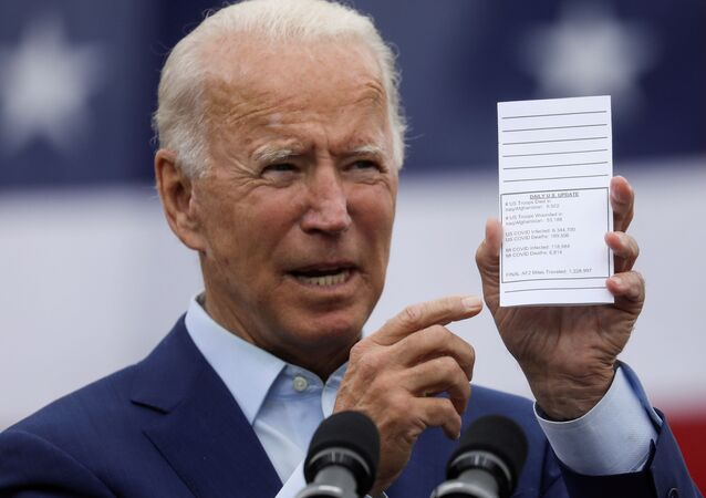 Democratic U.S. presidential nominee and former Vice President Joe Biden holds a copy of his schedule and notes as he delivers remarks during a campaign event in Warren, Michigan, U.S., September 9, 2020.