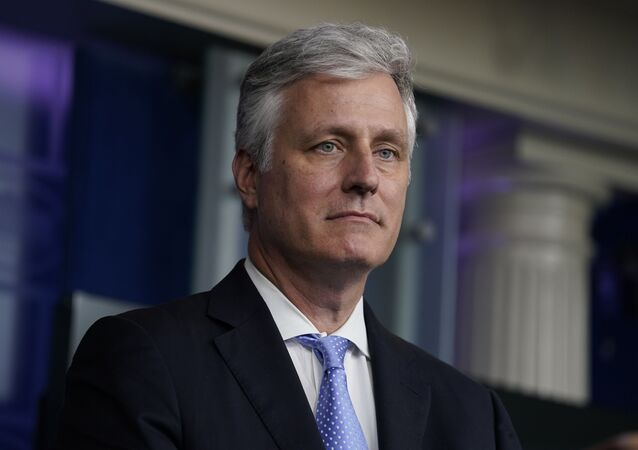 National security adviser Robert C. O'Brien listens during a news conference at the White House, Friday, Sept. 4, 2020, in Washington