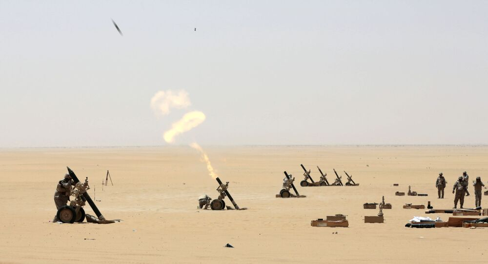 Saudi soldiers fire artillery towards the border with Yemen in Najran, Saudi Arabia, Tuesday, April 21, 2015