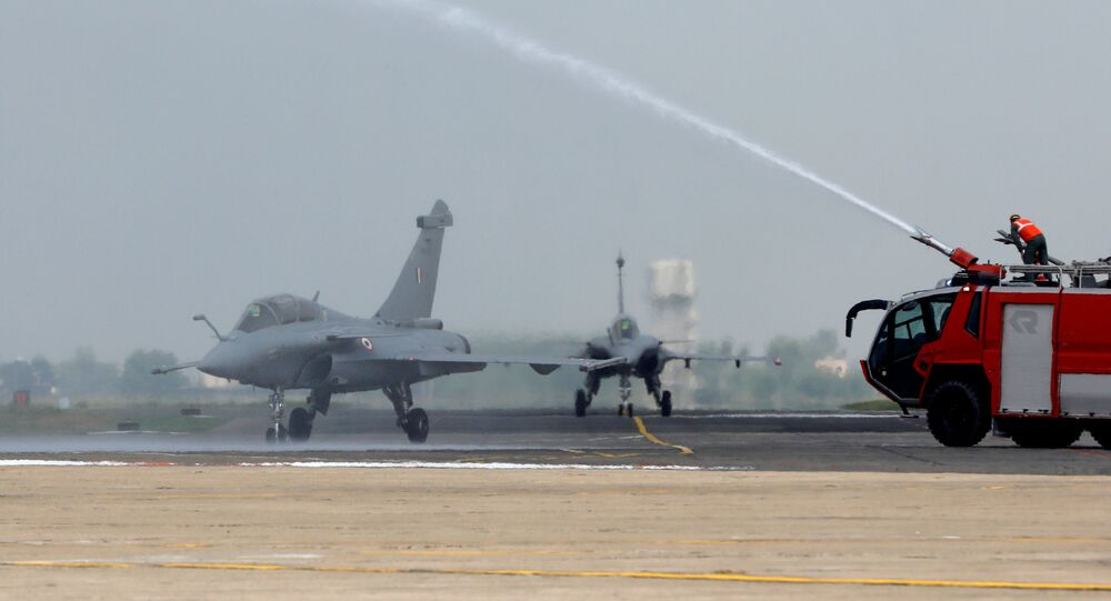 Rafale fighter jets receive a water cannon salute during its induction ceremony at an air force station in Ambala, India, September 10, 2020