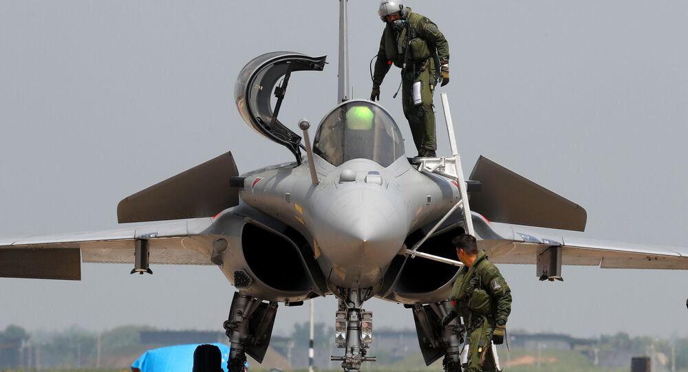 An Indian Air Force pilot gets out of a Rafale fighter jet during its induction ceremony at an air force station in Ambala, India, 10 September 2020