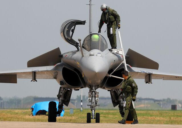 An Indian Air Force pilot gets out of a Rafale fighter jet during its induction ceremony at an air force station in Ambala, India, September 10, 2020