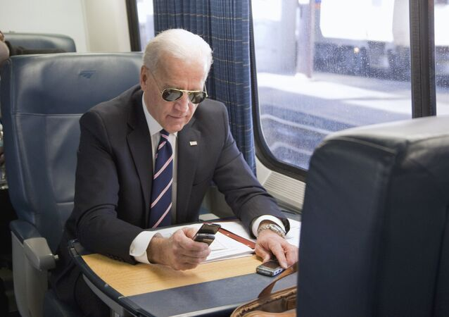 Vice President Joe Biden makes a phone call on a train at Union Station in Washington, Tuesday, Feb. 8, 2011, as he headed to an event in Philadelphia to tout plans to improve the nation's infrastructure