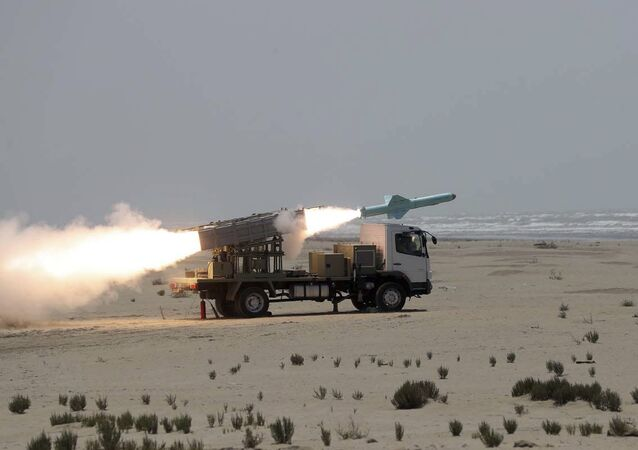 In this file photo provided on 18 June, 2020, by the Iranian Army, a missile is launched during a naval exercise.