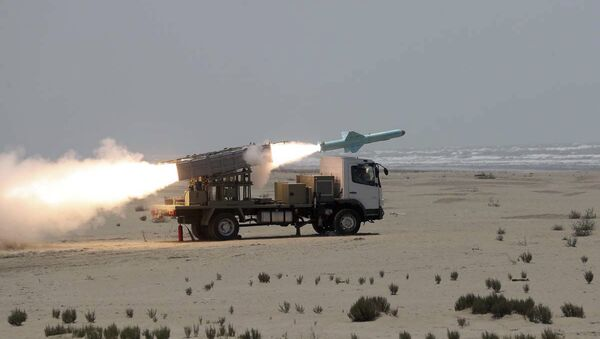 In this file photo provided on 18 June, 2020, by the Iranian Army, a missile is launched during a naval exercise. - Sputnik International