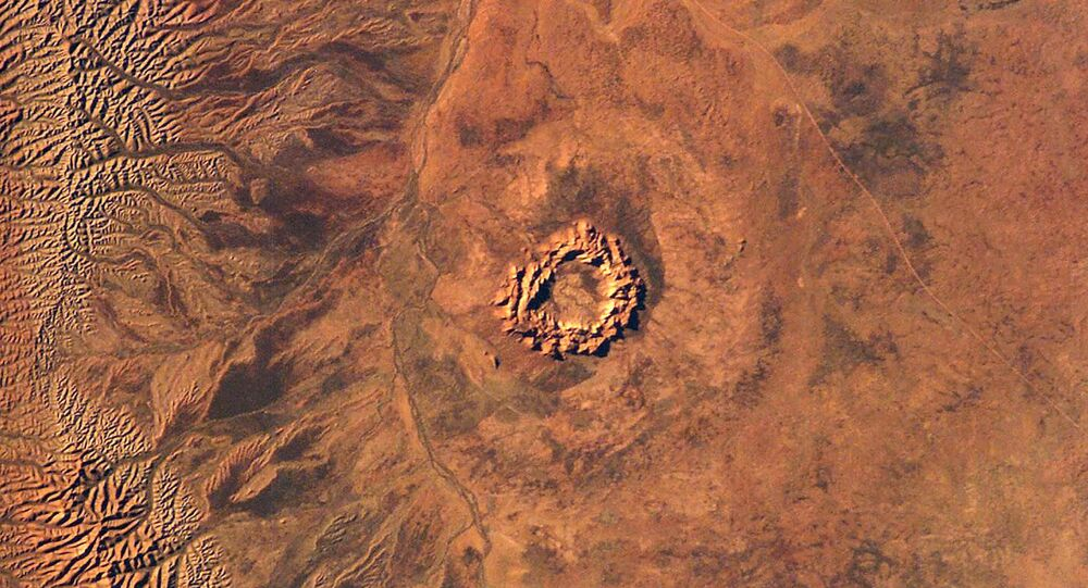 This handout image courtesy of NASA's Earth Sciences and Image Analysis Laboratory obtained 16 June 2003 shows Gosses Bluff, an impact crater in Australia's Northern Territory