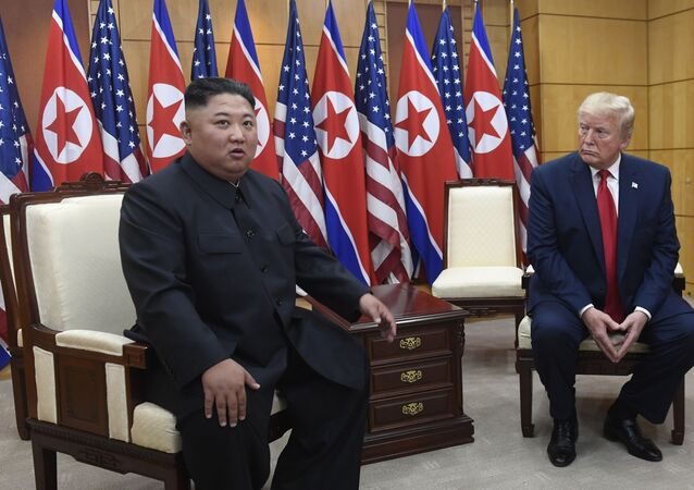 In this 30 June 2019, file photo President Donald Trump, right, listens as North Korean leader Kim Jong Un, left, speaks during their bilateral meeting inside the Freedom House at the border village of Panmunjom in the Demilitarised Zone, South Korea