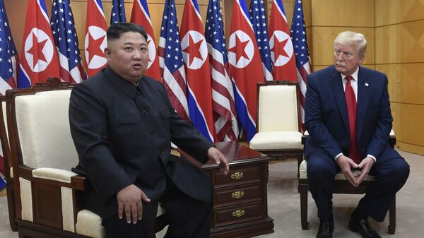 In this June 30, 2019, file photo President Donald Trump, right, listens as North Korean leader Kim Jong Un, left, speaks during their bilateral meeting inside the Freedom House at the border village of Panmunjom in the Demilitarized Zone, South Korea - Sputnik International