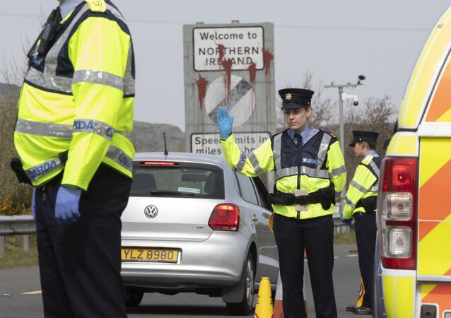 In this file photo taken on April 09, 2020 Irish Police (Garda) stop and check vechicles at the border crossing at Carrkcarnon, County Louth, Ireland, on April 9, 2020 under new powers to curb non-essential travel during the coronavirus crisis.