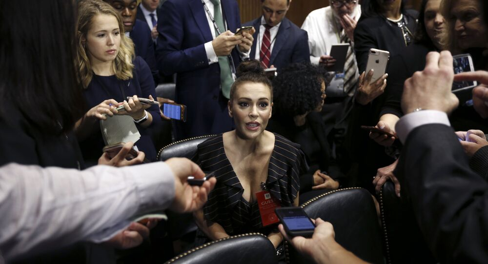 Actress Alyssa Milano talks to the media after she arrived for the Senate Judiciary hearing on Capitol Hill in Washington, Thursday, Sept. 27, 2018