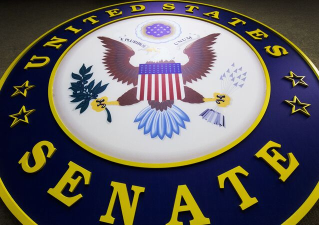 The seal for the US Senate hangs on the wall inside the Senate Radio-TV gallery on Capitol Hill in Washington, DC.