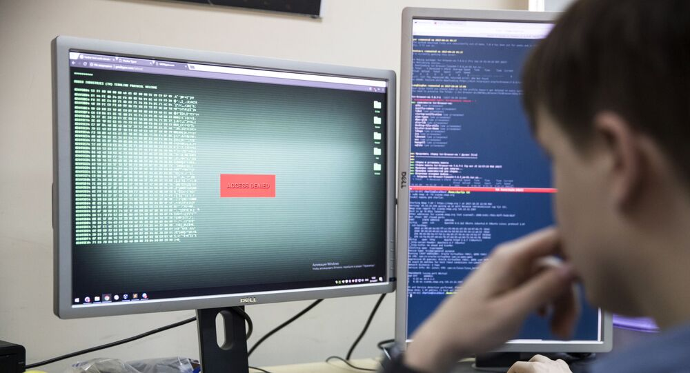 An employee of Global Cyber Security Company Group-IB develops a computer code in an office in Moscow, Russia, Wednesday, Oct. 25, 2017. A new strain of malicious software has paralyzed computers at a Ukrainian airport, the Ukrainian capital's subway and at some independent Russian media. Moscow-based Global Cyber Security Company Group-IB said in a statement Wednesday the ransomware called BadRabbit also tried to penetrate the computers of major Russian banks but failed. None of the banks has reported any attacks.