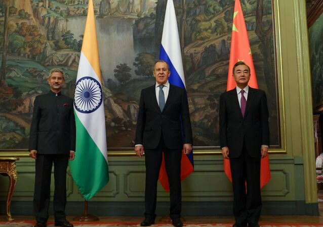 In this handout photo released by Russian Foreign Ministry, from left to right, Indian Foreign Minister Subrahmanyam Jaishankar, Russian Foreign Minister Sergei Lavrov and Foreign Minister of China Wang Yi pose for a family photo during their meeting in Moscow, Russia, 10 September 2020.