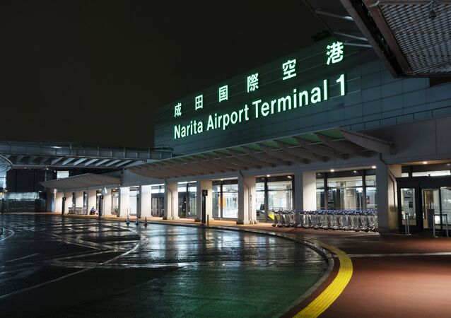 The airport driveway is empty with most international flights canceled at the Narita International Airport in Nairta, near Tokyo, Wednesday, April 1, 2020