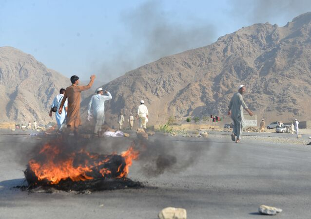 Men shout slogans against terrorists after a suicide attack among the protesters in Momandara district of Nangarhar province, Afghanistan, 11 September 2018. A suicide bomber detonated his explosives-filled vest among a group of people protesting against a local police commander in eastern Afghanistan on Tuesday, killing 25 and wounding about 130, a provincial official said.