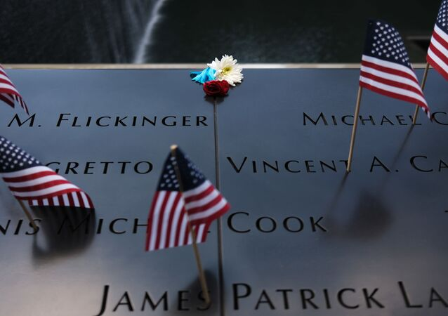 NEW YORK, NEW YORK - JULY 04: A flower is placed on a name at the 9/11 memorial plaza on the first day that it has reopened after closing for three months due to the coronavirus on on July 04, 2020 in New York City.