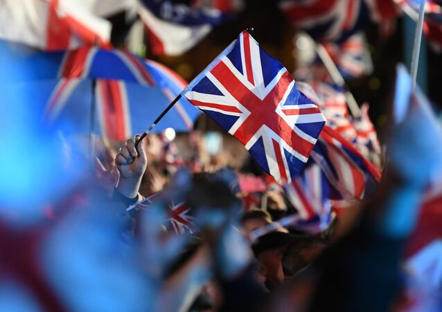 Brexit supporters wave Union flags as the time nears 11 O'Clock, in Parliament Square, venue for the Leave Means Leave Brexit Celebration in central London on January 31, 2020, the moment that the UK formally leaves the European Union.