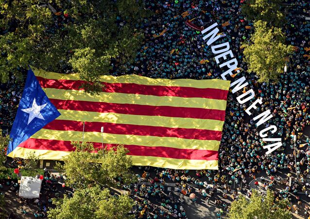 An aerial view of people waving a giant Catalan pro-independence Estelada flag during a demonstration marking the Diada, national day of Catalonia, in Barcelona on September 11, 2019.
