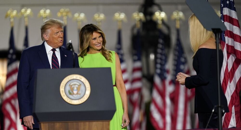 President Donald Trump and first lady Melania Trump smile at Ivanka Trump as they arrive on South Lawn of the White House on the fourth day of the Republican National Convention, Thursday, Aug. 27, 2020