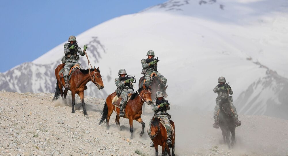 Chinese People's Liberation Army (PLA) soldiers take part in a training session at Pamir Mountains in Kashgar, in China's western Xinjiang region on August 28, 2020.