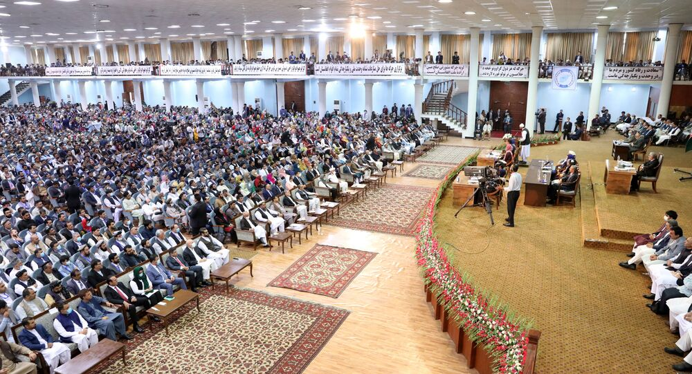 In this handout file photo taken on August 9, 2020 and released by the Press Office of President of Afghanistan, Afghan people attend on the last day of the Loya Jirga, a grand assembly, at the Loya Jirga Hall in Kabul.