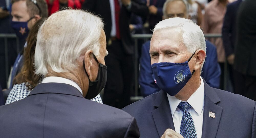 Democratic presidential candidate and former Vice President Joe Biden, left, greets Vice President Mike Pence, right, at the National September 11 Memorial and Museum, Friday, Sept. 11, 2020, in New York