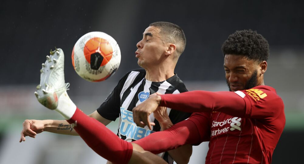 Liverpool's Joe Gomez, right, challenges Newcastle's Miguel Almiron during an English Premier League match in July 2020.