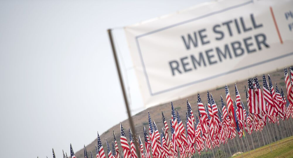 Some 3,000 flags comprise a 9/11 memorial at Pepperdine University in Malibu, California, on September 11, 2020, as the US commemorates the 19th anniversary of the attacks.