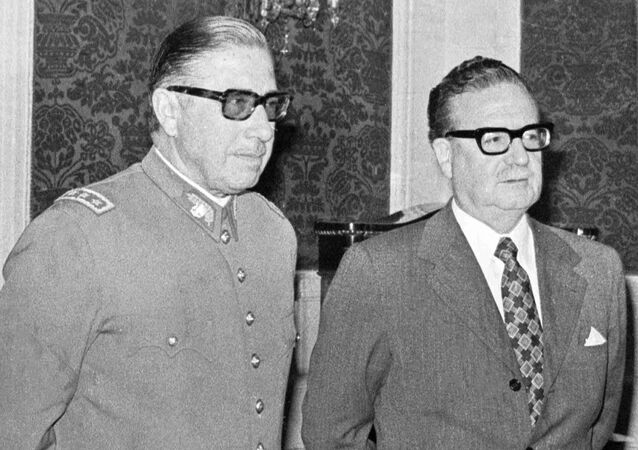 In this Aug. 23, 1973 file photo, Chilean Gen. Augusto Pinochet, left, and President Salvador Allende, attend a ceremony naming Pinochet as commander in chief of the Army. Chile marks the 45th anniversary of the coup led by Pinochet overthrowing Allende, on Wednesday, Sept. 11, 2018.