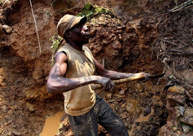 In this photo taken Aug. 17, 2012, one of the few remaining miners digs out soil which will later be filtered for traces of cassiterite, the major ore of tin, at Nyabibwe mine, in eastern Congo. Gold is now the primary source of income for armed groups in eastern Congo, and is ending up in jewelry stores across the world, according to a report published Thursday, Oct. 25, 2012, by the Enough Project. Following American legislation requiring companies to track the origin of the minerals they use, armed groups have been unable to profit from the exploitation of tin, tungsten, and tantalum, and have turned instead to gold, which is easier to smuggle across borders. Gold miners, like cassiterite miners, work in extreme conditions, with crude equipment such as pick-axes and shovels.