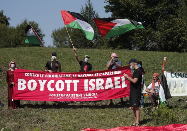 Cycling - Tour de France - Stage 8 - Cazeres-sur-Garonne to Loudenvielle - France - September 5, 2020. Pro-Palestine protesters demonstrate along the course.