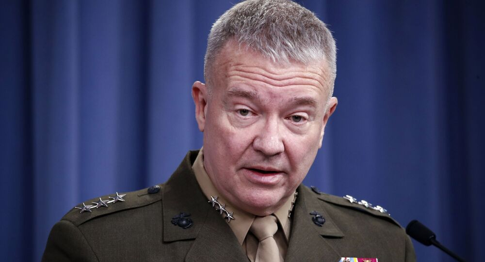 In this April1 14, 2018, file photo, then-Marine Lt. Gen. Kenneth Frank McKenzie speaks during a media availability at the Pentagon in Washington. McKenzie, the Marine general overseeing the U.S. war effort in Afghanistan says the Islamic State affiliate there has hopes of attacking the U.S. homeland. But McKenzie says the extremist group's aspirations are being frustrated by American counterterrorism operations in its strongholds in northeastern Afghanistan.