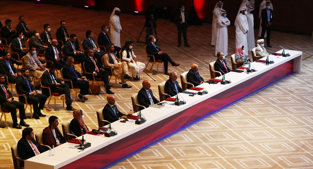 Delegates are seen before talks between the Afghan government and Taliban insurgents in Doha, Qatar September 12, 2020.