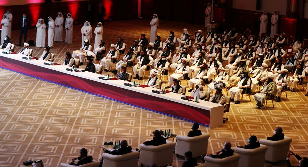 Delegates attend talks between the Afghan government and Taliban insurgents in Doha