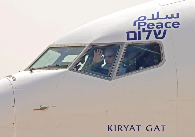 The captain of the El Al's airliner, which will carry a U.S.-Israeli delegation to the UAE following a normalisation accord, waves to spectators as they prepare for lift-off in the first-ever commercial flight from Israel to the UAE at Ben Gurion Airport, near Tel Aviv, Israel August 31, 2020.