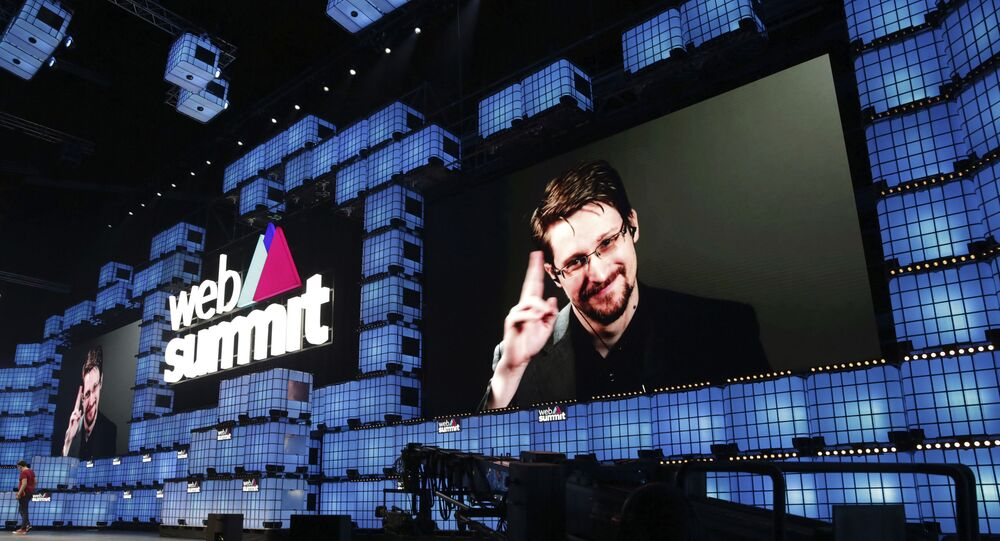 Former US National Security Agency contractor Edward Snowden addresses attendees through video link at the Web Summit technology conference in Lisbon, 4 November 2019. Snowden has been living in Russia to escape US prosecution after leaking classified documents detailing government surveillance programmes