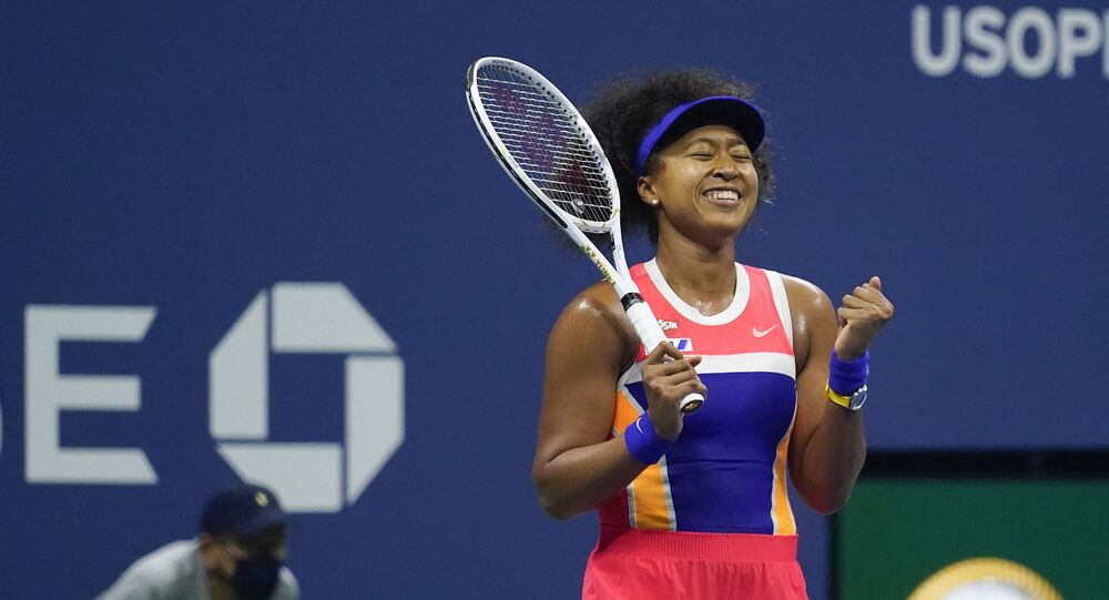 Naomi Osaka, of Japan, reacts after defeating Jennifer Brady, of the United States, during a semifinal match of the US Open tennis championships, Thursday, Sept. 10, 2020, in New York