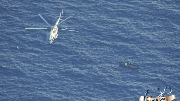 Aerial photo of a Mexican Navy helicopter flying over a speed boat suspected of being loaded with cocaine in the Caribbean Sea off the coast of the Mexican state of Quintana Roo, 1 September 2020. - Sputnik International