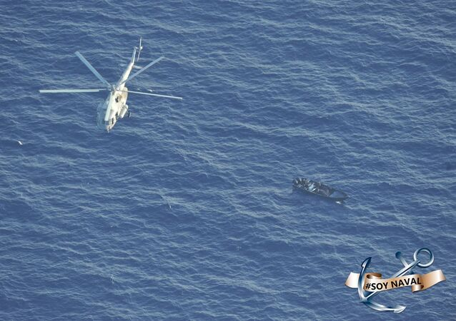 Aerial photo of a Mexican Navy helicopter flying over a speed boat suspected of being loaded with cocaine in the Caribbean Sea off the coast of the Mexican state of Quintana Roo, 1 September 2020.