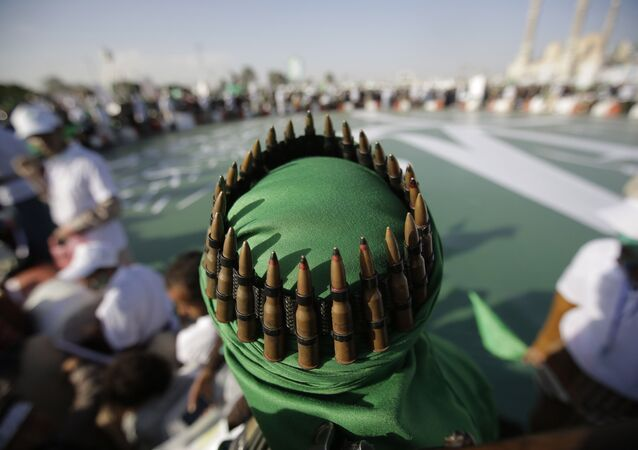 A supporter of Shiite rebels, known as Houthis, with an ammunition belt placed on his head attends a celebration of Moulid al-nabi, the birth of Islam's prophet Muhammad in Sanaa, Yemen, Saturday, Nov. 9, 2019