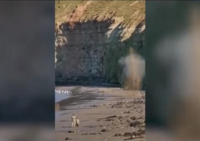Screenshot from a video showing a bomb disposal team detonating an old grenade in Cat Nab, Saltburn, UK