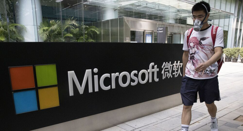 A man wearing a mask walks past the Microsoft office in Beijing, China on Friday, Aug. 7, 2020. U.S. President Donald Trump on Thursday ordered a sweeping but unspecified ban on dealings with the Chinese owners of consumer apps TikTok and WeChat, although it remains unclear if he has the legal authority to actually ban the apps from the U.S. Earlier in the week, Trump threatened a deadline of Sept. 15 to close down TikTok unless Microsoft or another company acquires it, a threat the new executive order appears to formalize