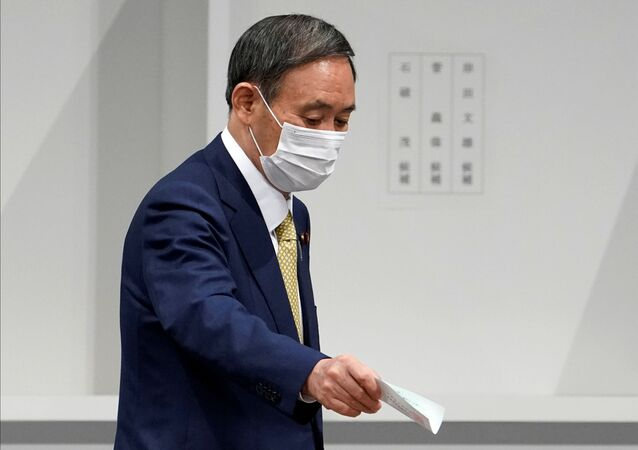 Japanese Chief Cabinet Secretary Yoshihide Suga casts his ballot at the Liberal Democratic Party's (LDP) leadership election in Tokyo, Japan September 14, 2020.