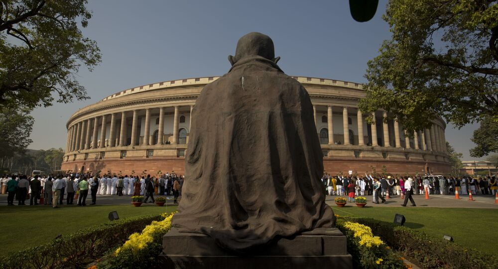 A statue of Mahatma Gandhi overlooks the Indian parliament building (File)